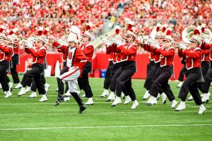UW Madison Marching Band marching down the field at Camp Randall