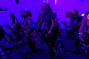 Students take part in a glow-in-the-dark group fitness class held at the Natatorium by Recreational Sports at the University of Wisconsin-Madison on Sept. 20, 2018. Fitness sessions included cinema spin, zumba and yoga options.(Photo by Bryce Richter / UW-Madison)