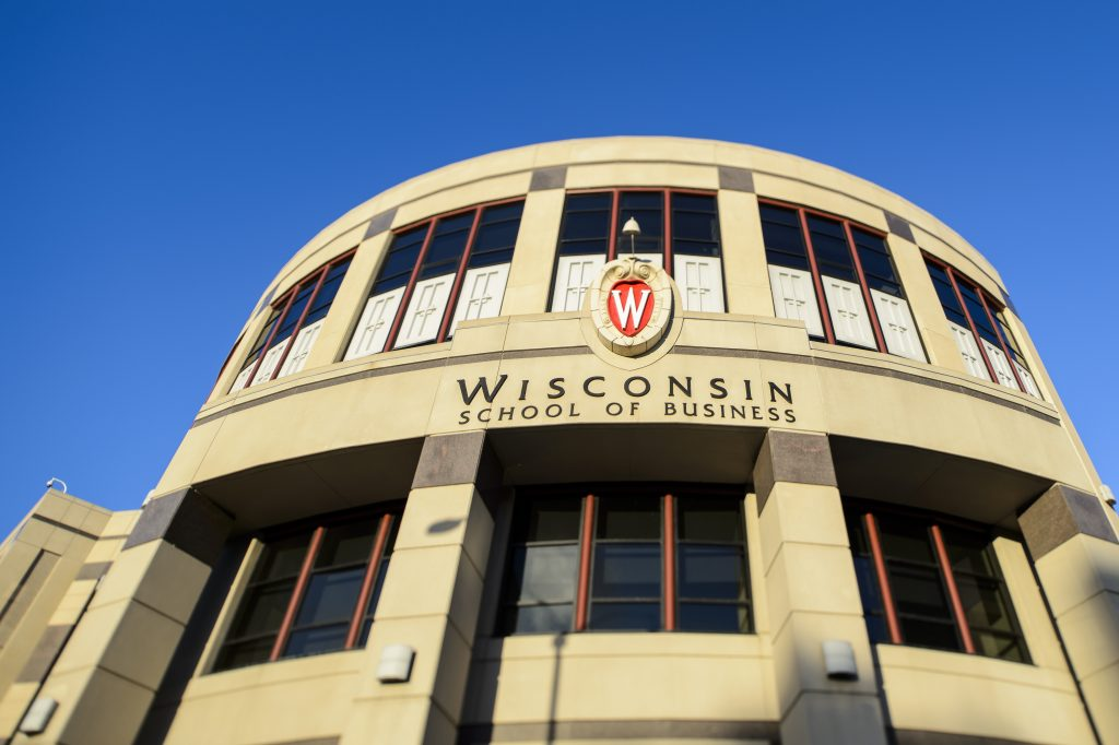 The rising sun shines on Grainger Hall, home to the Wisconsin School of Business at the University of Wisconsin-Madison, during a summer morning on July 9, 2016. The photo was made using a tilt-shift focusing lens. (Photo by Jeff Miller/UW-Madison)