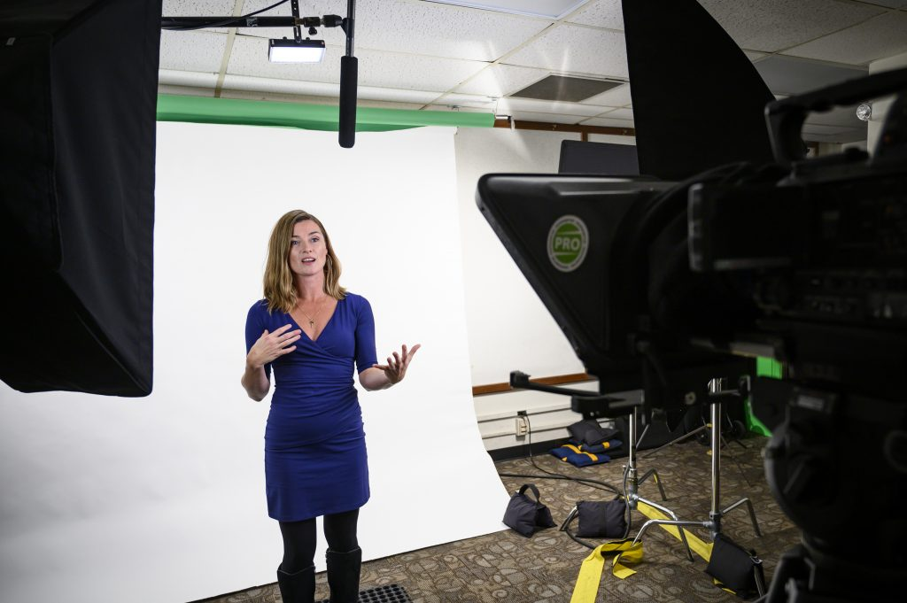 On March 5, 2019, Sara Mckinnon, associate professor of communication arts at the University of Wisconsin-Madison, lectures in front of a studio backdrop in the Computer Science Building as she creates content for her ComArts 371 and 373 online courses. McKinnon is the recipient of a 2019 Distinguished Teaching Award. (Photo by Bryce Richter /UW-Madison)