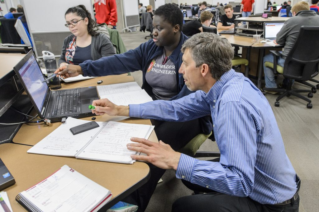 Barry Van Veen (right), professor of computer and electrical engineering, works with students in his ECE 330: Signals and Systems class in the Wisconsin Collaboratory for Enhanced Learning (WisCEL) on the fourth floor of Wendt Library at the University of Wisconsin-Madison on April 9, 2015. Van Veen is the recipient of a 2015 Distinguished Teaching Award. (Photo by Bryce Richter / UW-Madison)